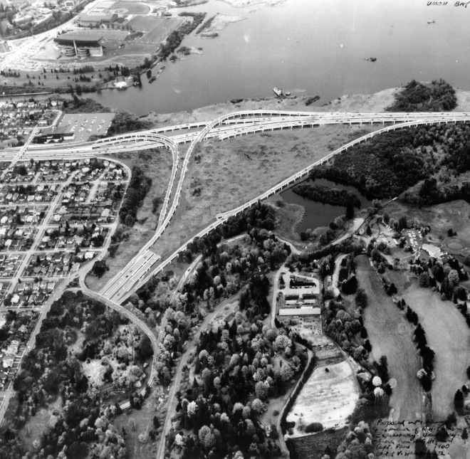 Aerial view of what was built in 1963. Husky Stadium and the Montlake Cut are in the upper left, Foster Island is in the upper right. The Arboretum is in the lower left and the Broadmoor Golf Course is lower right.